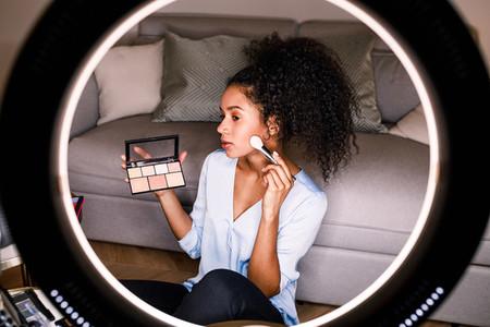 Woman beauty vlogger recording