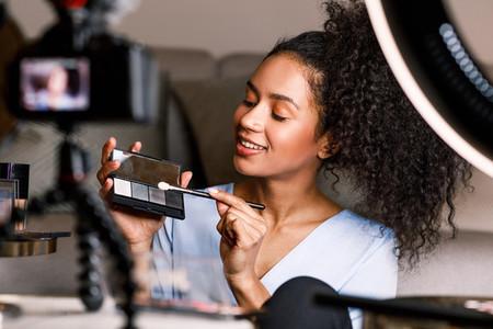 Beautiful woman holding a makeup