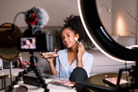 Beauty vlogger making a video