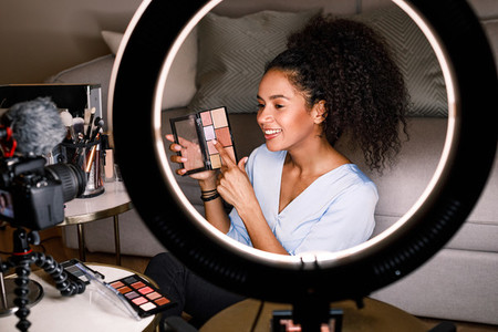 Woman vlogger recording video