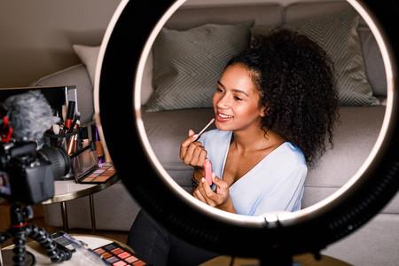 Woman recording makeup tutorial