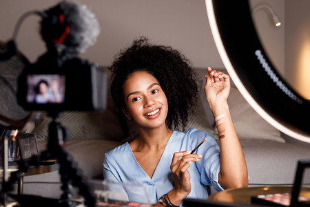 Young woman recording video