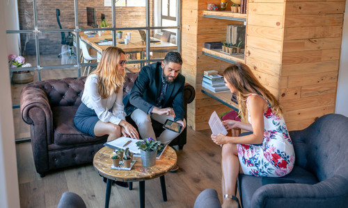Businesspeople having an informal work meeting