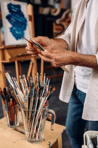 Cropped shot of artist choosing