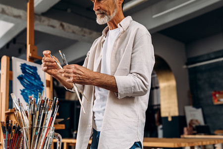 Male painter standing in studio