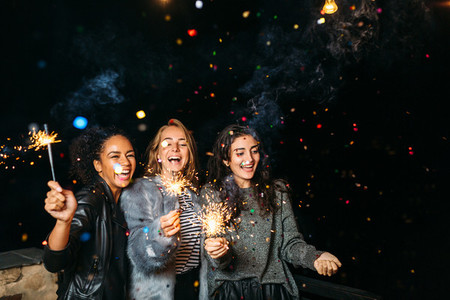 Three happy women having fun