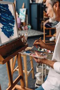 Senior artist working in studio