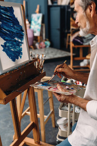 Senior artist working in studio