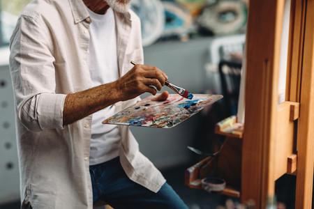 Male hand holding paintbrush