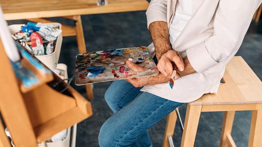 Unrecognizable male painter