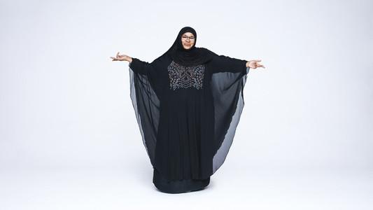 Islamic woman in hijab looking at camera