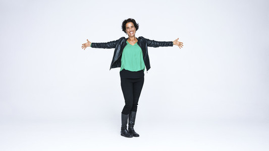 Happy woman in jacket and boots