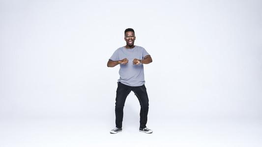 Happy african man dancing in joy