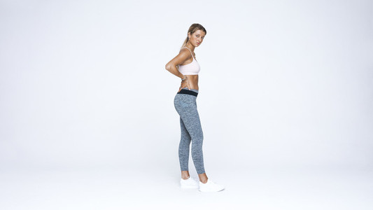 Woman standing in workout clothes