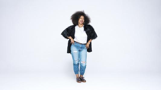 Woman in afro hairstyle having fun