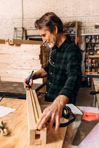 Side view of senior carpenter