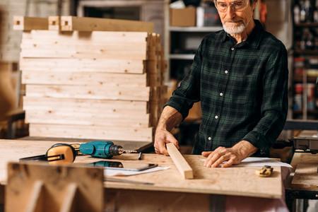 Cropped shot of mature carpenter
