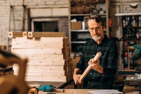 Carpenter checking wood part