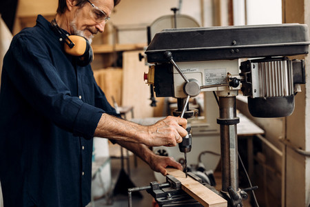 Mature worker in carpentry