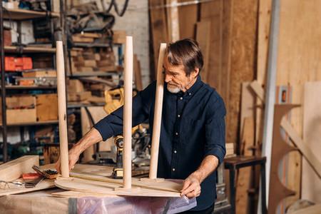 Mature carpenter measures
