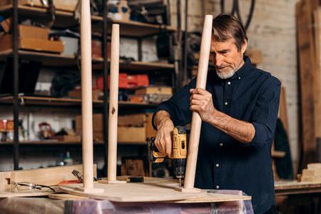 Senior carpenter repairing