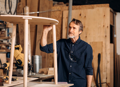 Senior carpenter standing