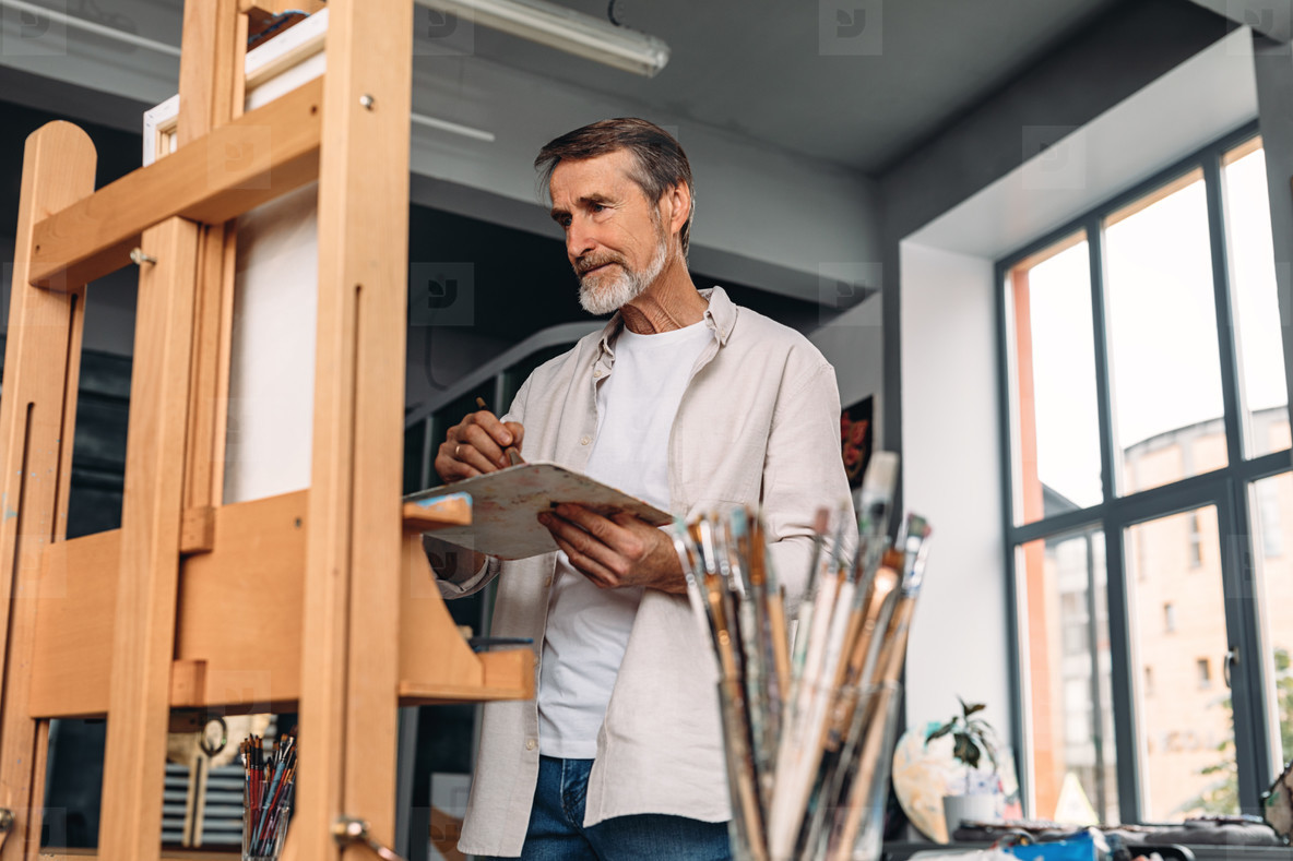 Male painter standing