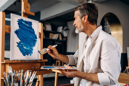 Bearded artist sitting