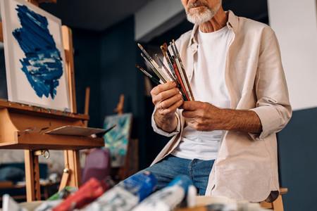 Man working as painter checking