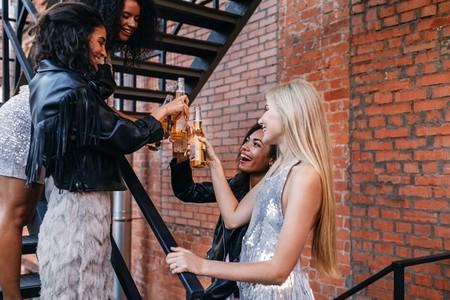 Friends toasting beer bottles