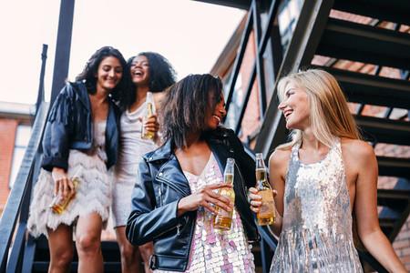 Happy women walking with bottles