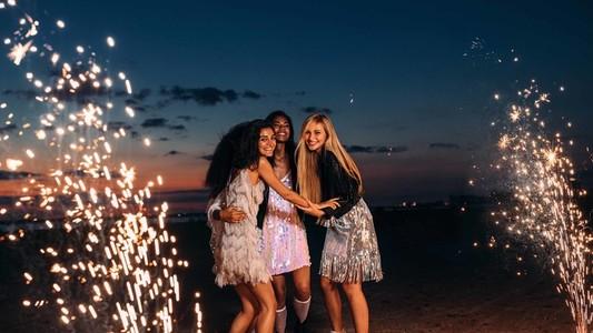 Four happy women celebrating