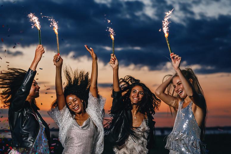 Four happy female friends