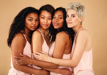 Four beautiful women hugging
