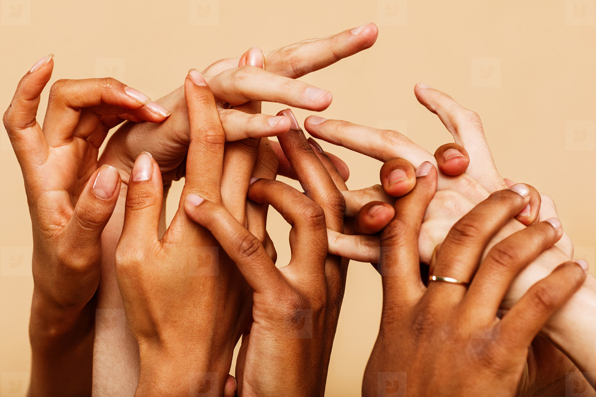 Close up shot of group of hands