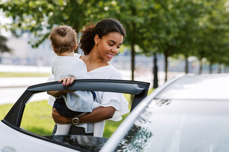 Woman opening a car door