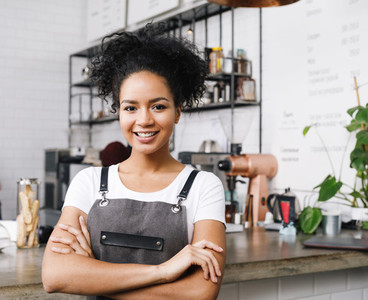 Cafe owner standing with arms
