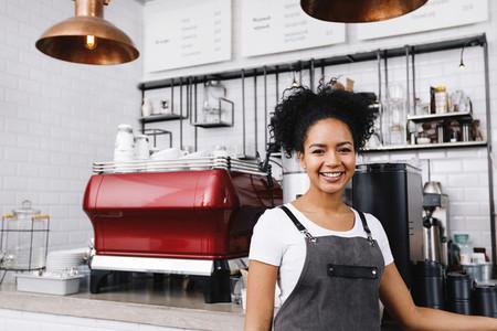 Young happy barista