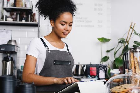 Waitress using digital tablet