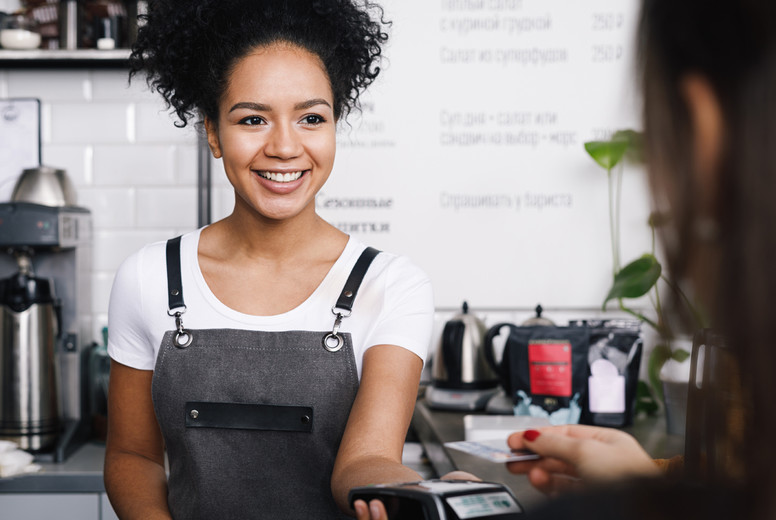 Smiling cashier accepting paymen