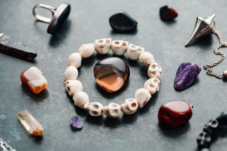 Magic flat lay  Various precious and semiprecious stones on a blue background for witchcraft