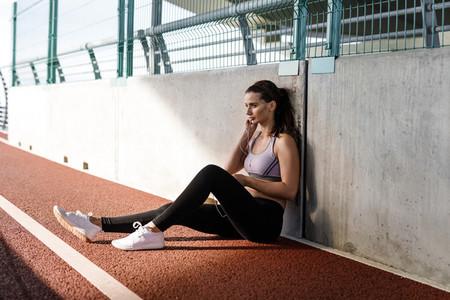 Young sportswoman with earphones