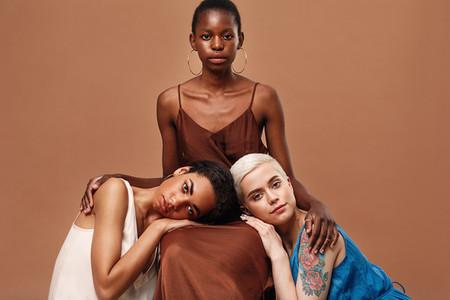 Three beautiful women posing