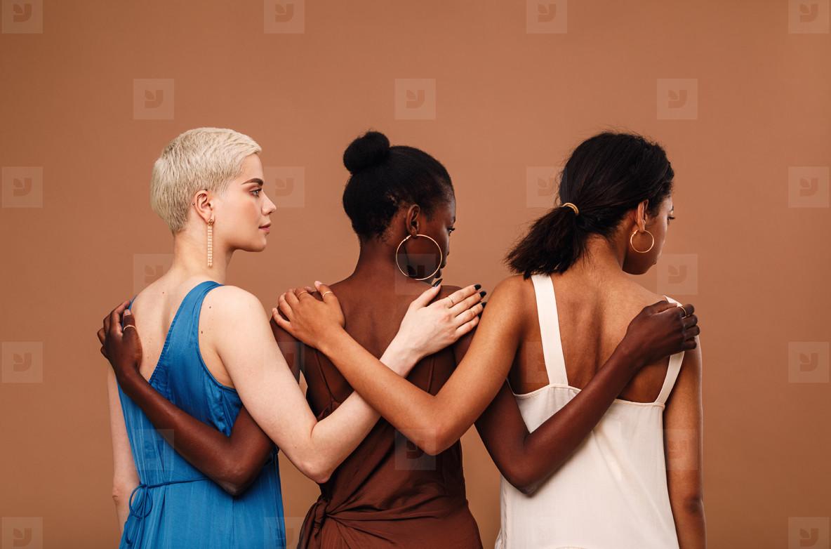 Three diverse women standing
