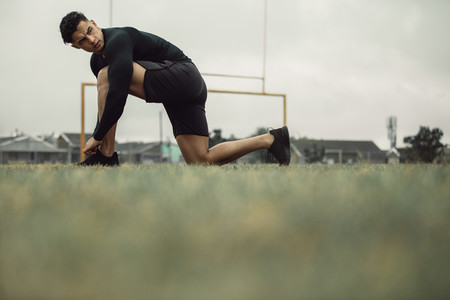 Athlete tying his shoe laces