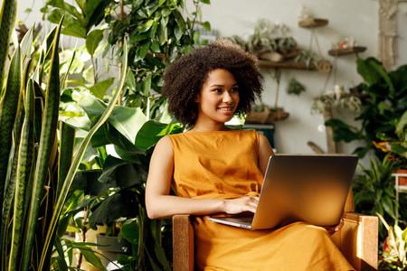 Female botanist typing on laptop