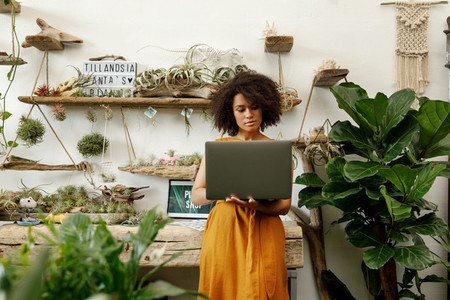Young woman standing with laptop