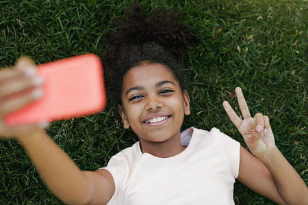 Smiling girl lying on a grass