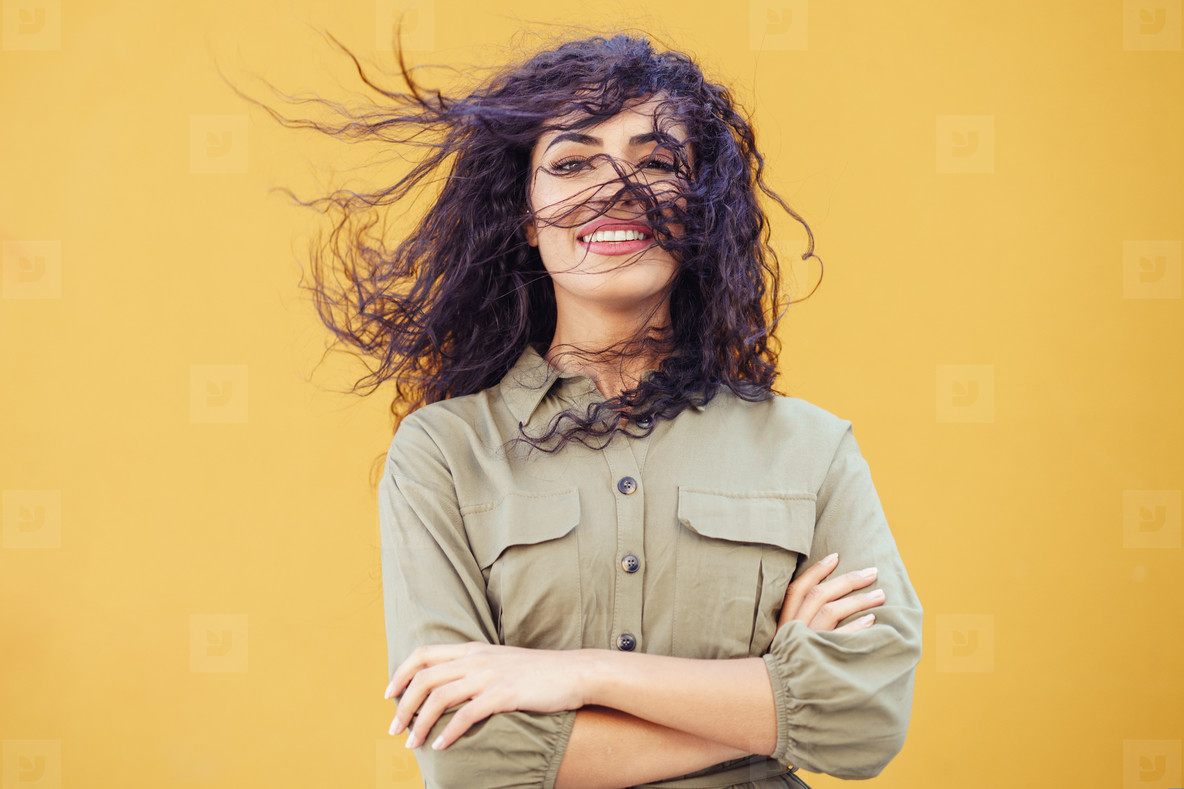 Arab Woman with curly hair in her face