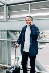 Senior man using mobile phone